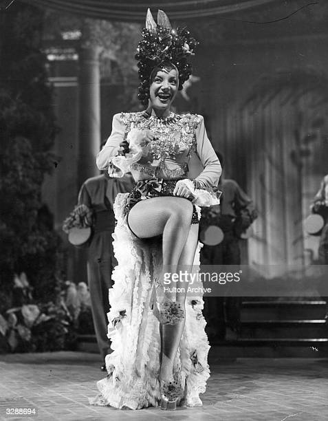 Brazilian singer and actress Carmen Miranda known as the 'Brazilian Bombshell' in a scene from an unknown film