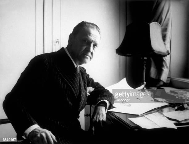 British writer Somerset Maugham at work in his London hotel