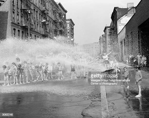 Children playing in the cool spray from a fire hydrant during a New York summer Photo by Weegee/International Center of Photography/Getty Images