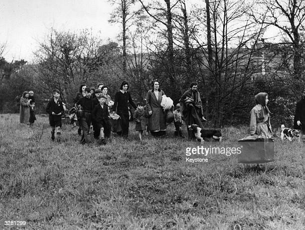Citizens of Portsmouth trying to find sleeping accommodation in the nearby countryside after severe bombing raids on their city