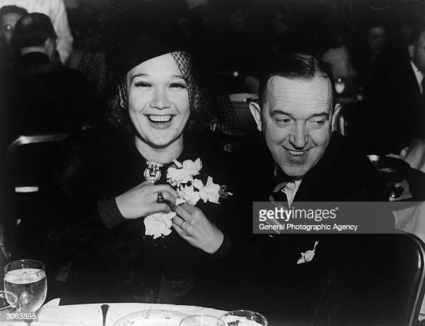 Comic actor Stan Laurel dining out with his wife Ileanna a Russian dancer