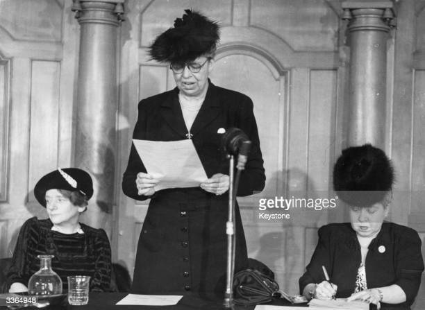 Eleanor Roosevelt American humanitarian and wife of President Franklin Delano Roosevelt speaking at a conference With her are British Labour...