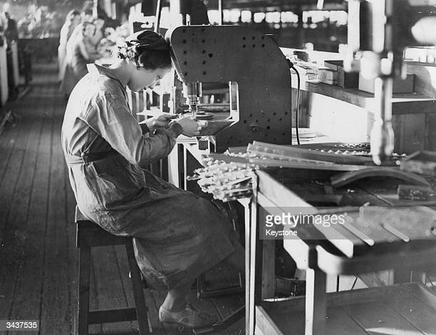 Factory workers at Vickers Supermarine Works Southampton drilling parts for the Spitfire one of the RAF's fighter planes