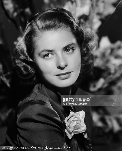 Film star Ingrid Bergman with a rose in her buttonhole.