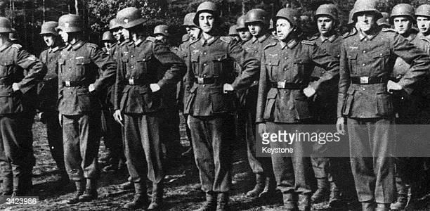 French collaborators, wearing Nazi uniforms.
