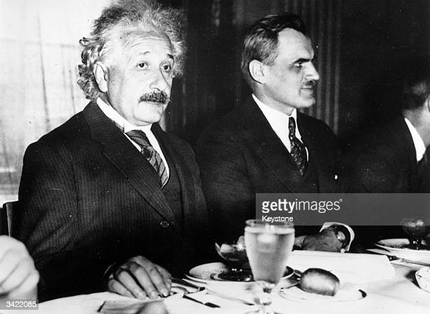 German-born American physicist Albert Einstein with American physicist Arthur Compton at the University of Chicago.