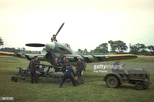 Ground staff prepare to load a Hawker Typhoon with bombs