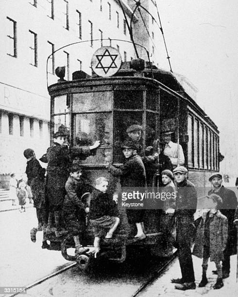 Jewish children on a tram in Warsaw's ghetto.