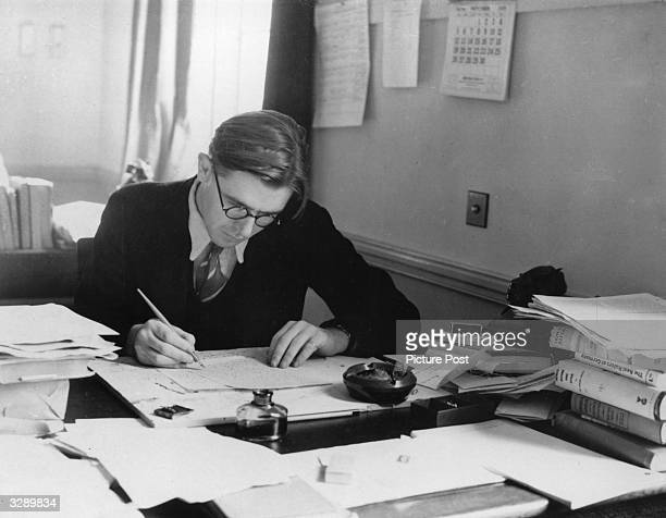 Journalist civil servant and future Labour politician Richard Crossman writing at his desk at the Ministry of Information Original Publication...