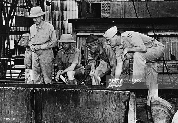 Lieutenant General Joseph Stilwell Commader in Chief of US forces with allied forces at a port in Eastern India unloading supplies from a merchant...