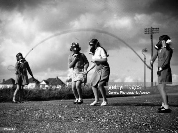 London children wear their gas masks as they skip in the park at their temporary homes on the south coast of England.
