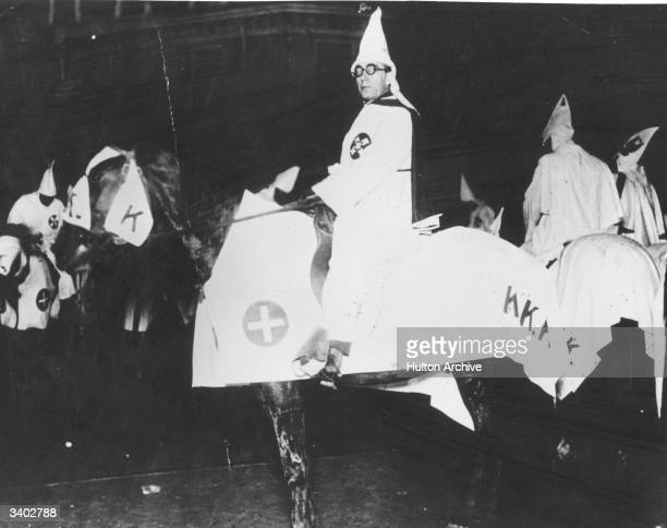 Members of the rightwing white supremacist organisation the Ku Klux Klan at a secret meeting