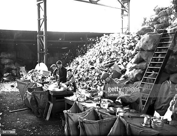 Men sorting scrap metal to be melted down.