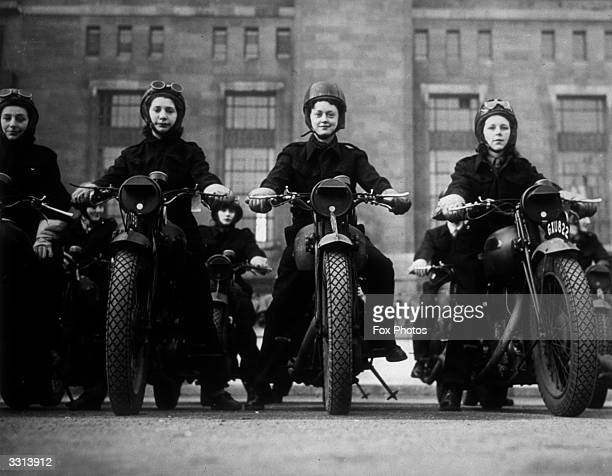 Ministry of Information dispatch riders on their motorbikes.