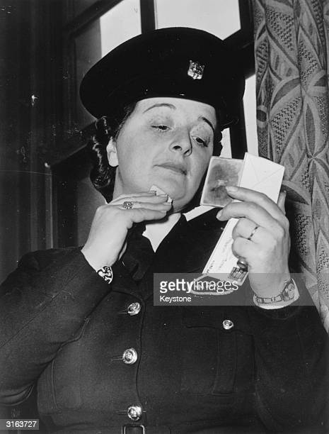 Mrs Russell of the Womans Auxiliary Police Corps in Preston maintains that a police uniform does not mean that the wearer should be drab or dull