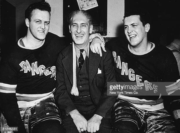 Circa 1940 New York Rangers hockey team manager Lester Patrick posing with his sons Rangers players Lynn left and Muzz