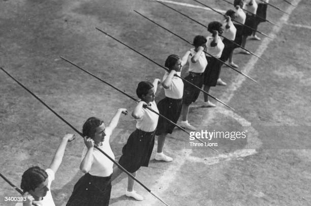 Physical training using javelins for the Giovani Italiano Italian fascist girls organisation