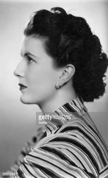 Profile of brunette Anne Boyd