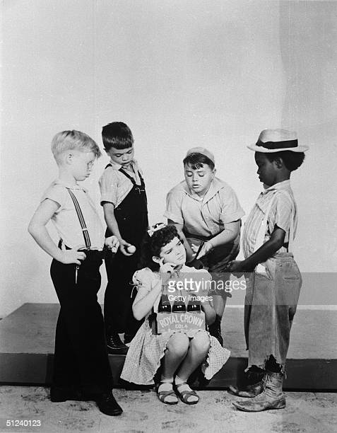 Circa 1940 Promotional portrait for the film series 'Our Gang' Standing left to right Billy Laughlin Robert Blake George McFarland and Billie Thomas...