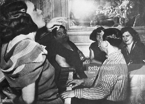 Prostitutes entertaining a German officer in a brothel requisitioned for the use of Nazis.