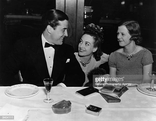 Ray Milland Joan Crawford and Mrs Irving Berlin celebrating Crawford's birthday at The Trocadero