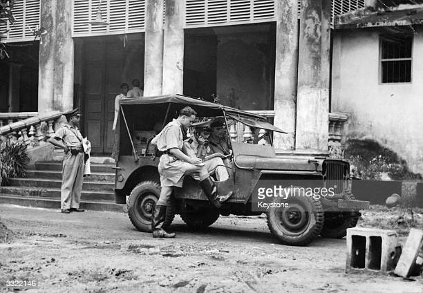 Soldiers manning a wireless van during Indian leader Mahatma Gandhi's 73 hour fast receive news about the riots from police headquarters at Lalbazar