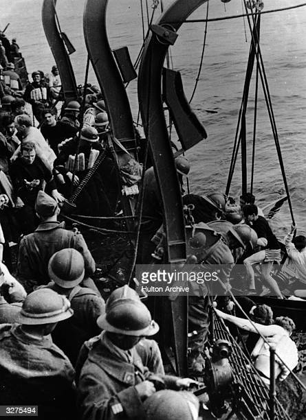 Some of the 330000 men saved from Dunkirk are picked up by a French boat in midchannel
