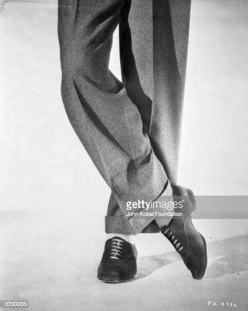 The elegantly crossed legs of Hollywood actor and dancer Fred Astaire