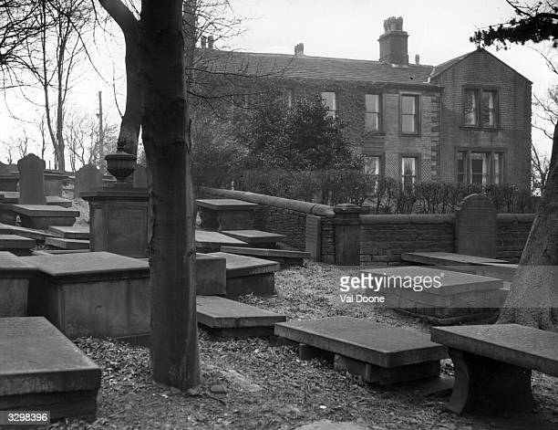 The Parsonage in Haworth North Yorkshire home of the Bronte family seen from the graveyard