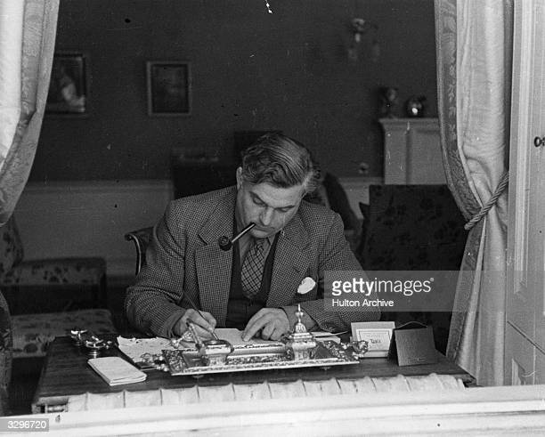 The Scottish Conservative politician Sir Robert John Graham Boothby KBE, , 1st Baron Boothby of Buchan and Rattray Head, at his desk.