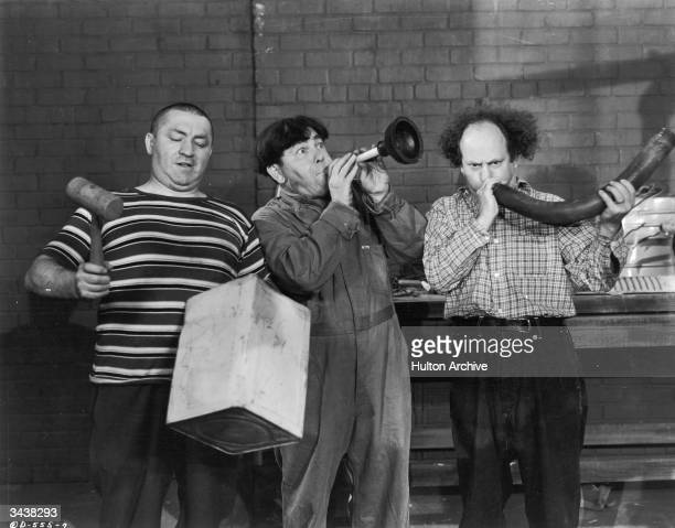 The Three Stooges turn plumbing equipment into musical instruments in a still from an unidentified film LR Curly Howard Moe Howard and Larry Fine