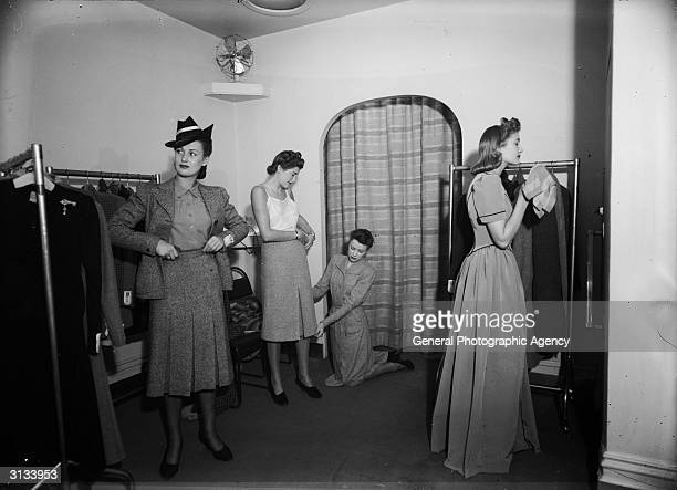 Women trying on outfits in the fitting room of an Army and Navy store in Britain
