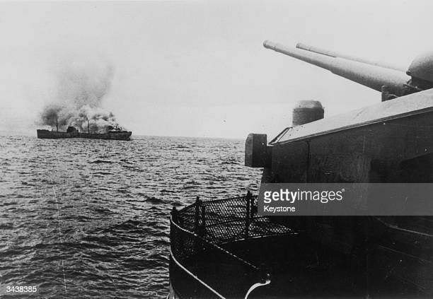 A view of the German battleship Bismarck firing on a merchant ship in the north Atlantic The Bismarck was sunk after attack by the British fleet on...