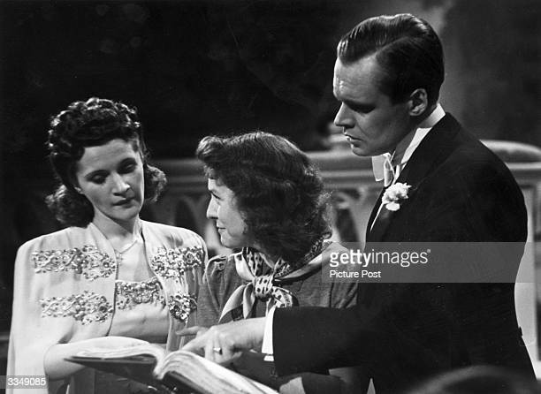 Actress and former dancer Barbara Mullen and German actor Albert Lieven read through the script again before filming a scene for 'Jeannie', a comedy...