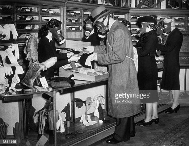 Employees and customers at a Bayswater store London wearing gas masks as part of a daily drill
