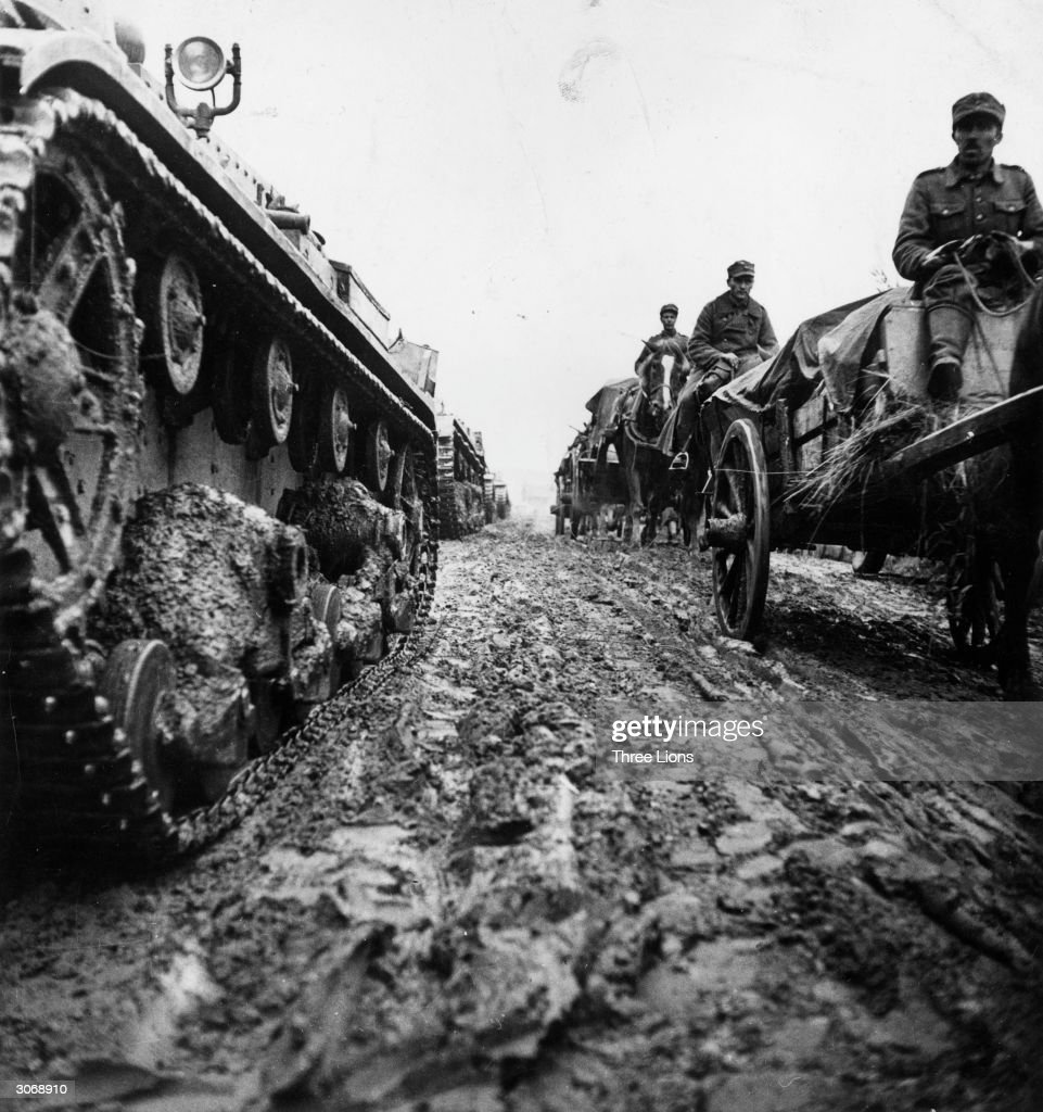 Finnish tanks and supply wagons make their way through muddy conditions in Karelia.