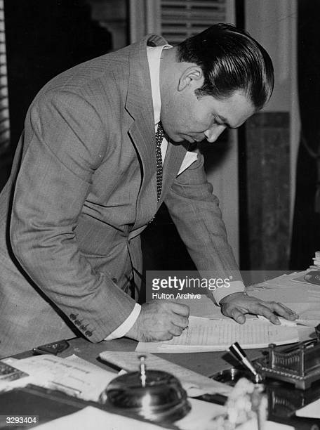 Fulgencio Batista Cuban dictator signing the decree acted upon by the Cuban Congress putting Cuba at war against Japan as an ally to the United States