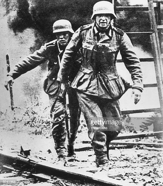 German shock troops stride purposefully through a burning village in Russia