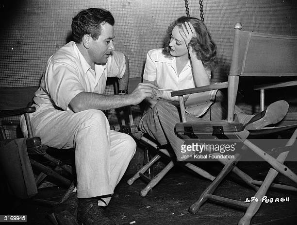 Hollywood director William Wyler on the set of 'The Little Foxes' with actress Bette Davis