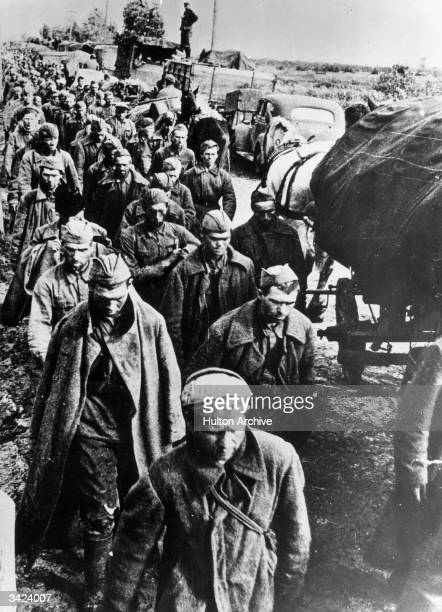 Lines of Soviet prisoners of war marching towards a prison camp