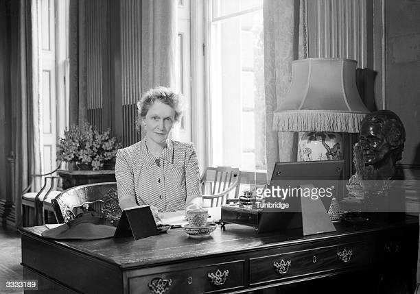 Nancy, Lady Astor MP at her desk at Cliveden, her home which has been turned into a hospital for Canadian wounded during WW II.