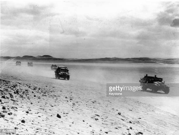 New British army antitank guns being raced across the Egyptian Desert in their special carriers during exercises in the Egyptian desert