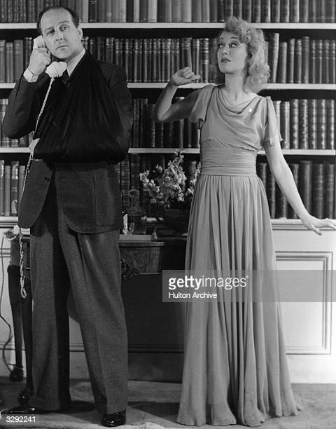 Scene from the play Blithe Sprit being performed at the Piccadilly Theatre with Cecil Parker on the phone and Kay Hammond as his second wife Ruth