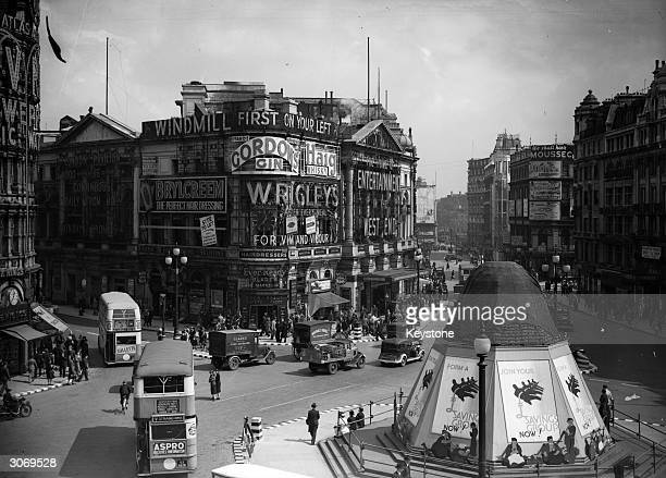 The Eros Statue in Piccadilly Circus London sandbagged for protection during World War II and known as the 'finest advertising site in the Empire'