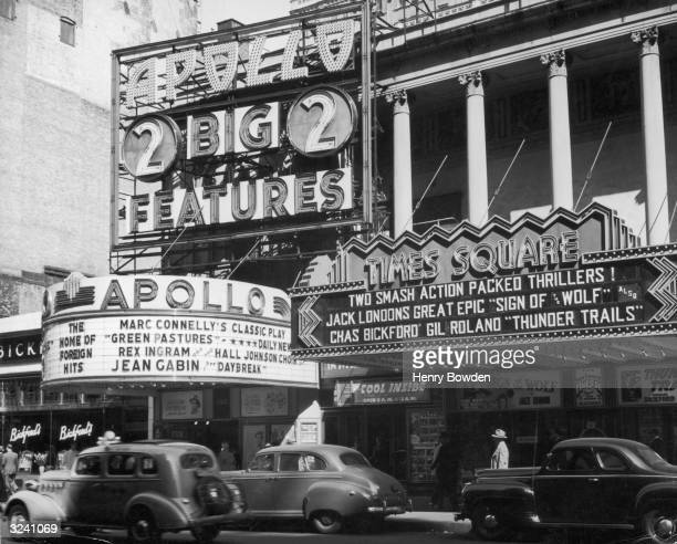 The marquees of the Apollo and Times Square theaters in the Harlem neighborhood of New York City