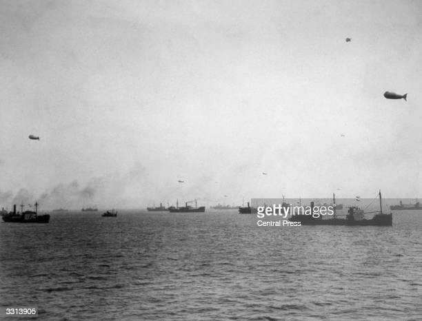 The scene at a British port where a large convoy of merchant seamen assembled under the watchful eye of the Royal Navy