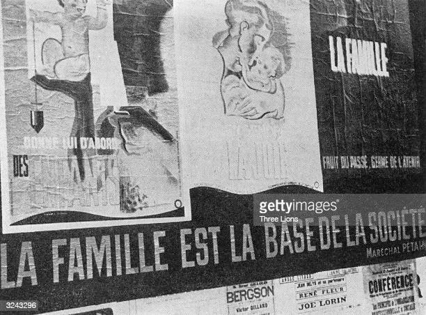 Vichy propaganda posters cover this wall they promote the 'family' and read 'The Family Fruit of the Past Seed of the Future' and 'The Family is the...