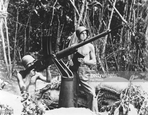 Machine gun captured from the Japanese at Guadalcanal is being used by two American marines.