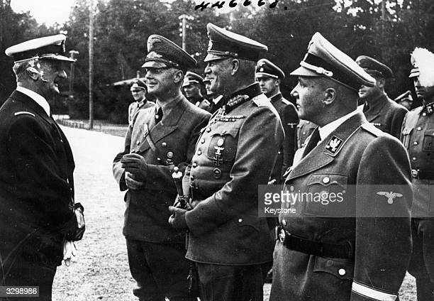 Admiral Miklos Horthy of Hungary with General Joachim von Ribbentrop Field Marshal Wilhelm Keitel and Rudolf Hess' successor Martin Bormann at...
