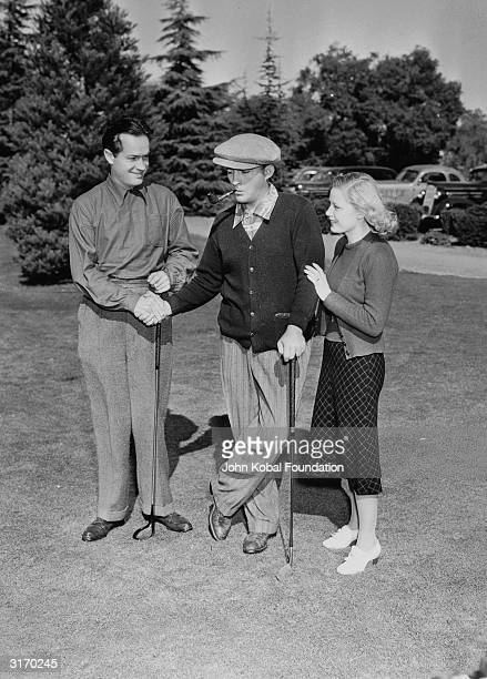 American comedian and actor Bob Hope on the golf course with actress Mary Carlisle and Bing Crosby , his co-star in the series of 'Road to...' films.